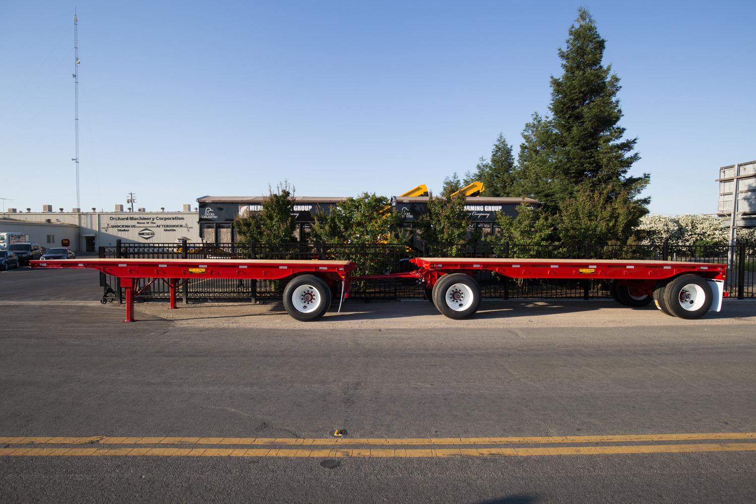 red wesco flatbed trailer on a road